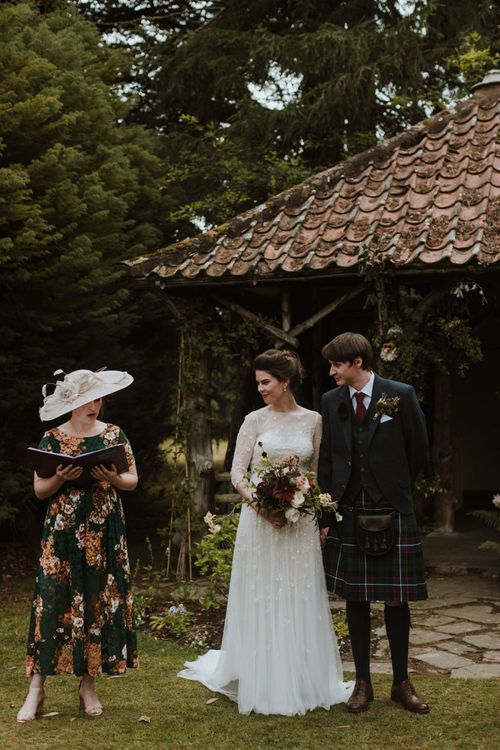 Outdoor Humanist Wedding Ceremony with Bride in Embroidery and Floral Embellished Wedding Dress and Groom in Tartan Kilt