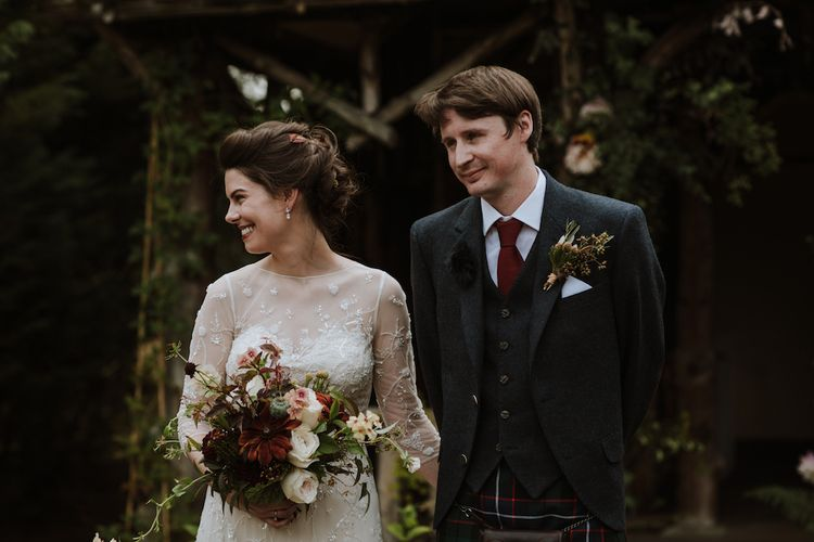 Outdoor Wedding Ceremony At Errol Park Wedding Venue with Bride in Embroidery and Floral Embellished Wedding Dress and Groom in Tartan Kilt