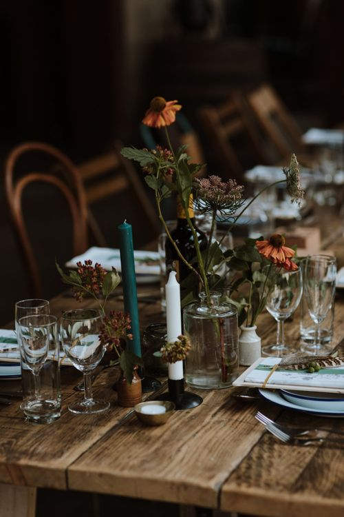 Flower Stems in Bottles and Coloured Candles