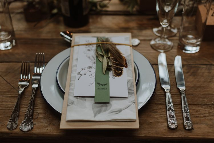 Place Setting with Greenery and Feather Decor