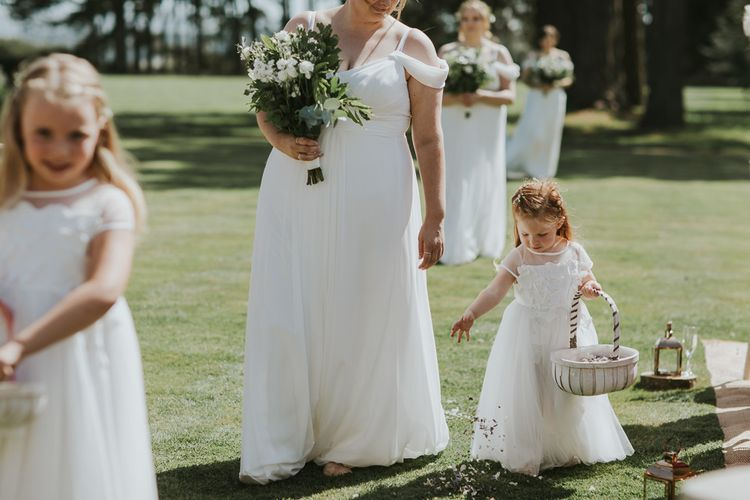 Bridesmaids And Flower Girls In White Dresses // Blush Pink Wedding Dress For Outdoor Wedding Ceremony At Hethfelton House With Images From Dorset Wedding Photographer Paul Underhill
