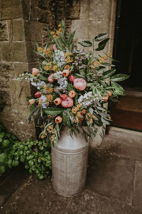 Milk Churn Filled with Colourful Spring Wedding Flowers including Pink Peonies