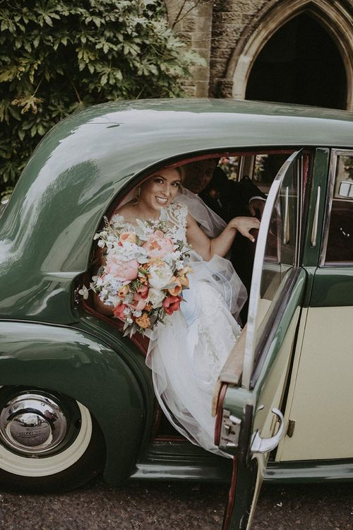 Bridal Party Arrival in Vintage Wedding Car
