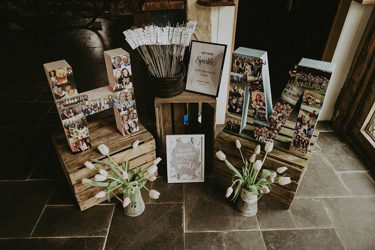Wedding Decor and Details with Sparklers, Wooden Crates, and Polaroid Picture Covered Initials