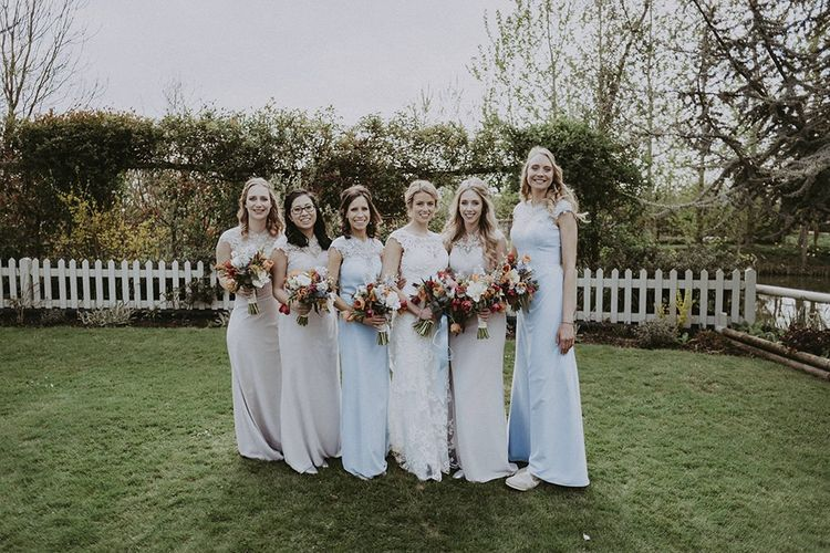 Bridal Party with Bridesmaids in Pastel Dresses and Bride in Everly Maggie Sottero Wedding Dress