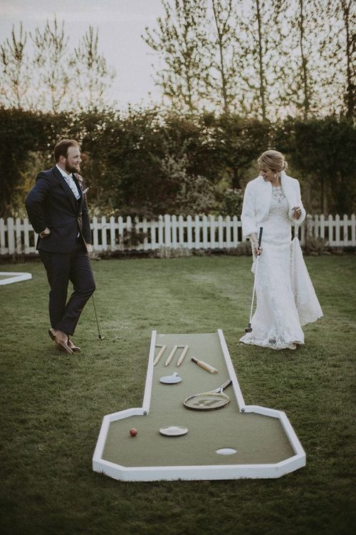 Bride and Groom Playing Crazy Gold Wedding Garden Games