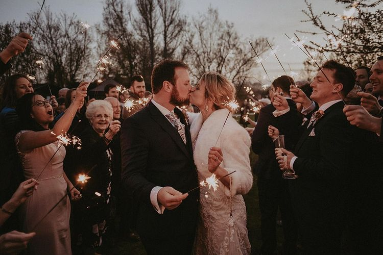 Bride and Groom Sparkler Moment with Bride in Faux Fur Stole