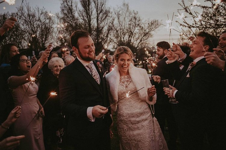 Sparkler Moment with Bride in Lace Maggie Sottero Wedding Dress and Groom in Navy Suit
