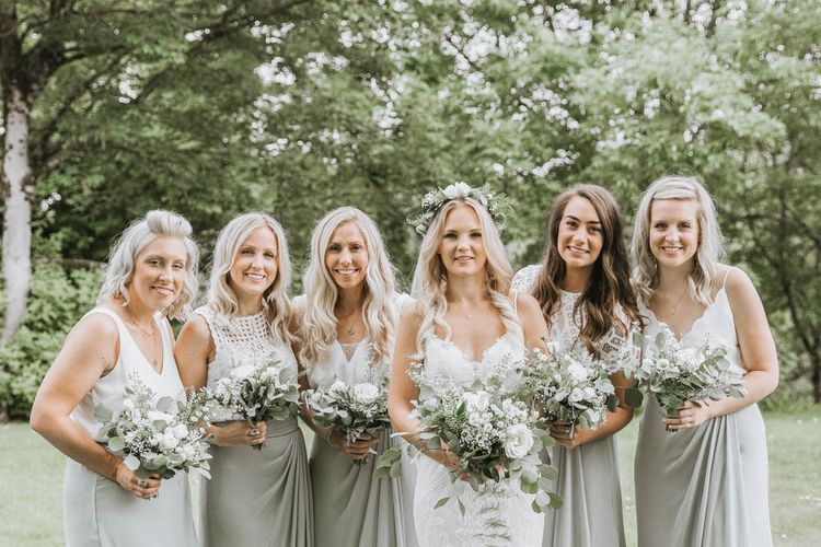 Bridal Party with Bride in Lace Wedding Dres and Bridesmaids  in Different Dresses from The Bridal House o Cornwall