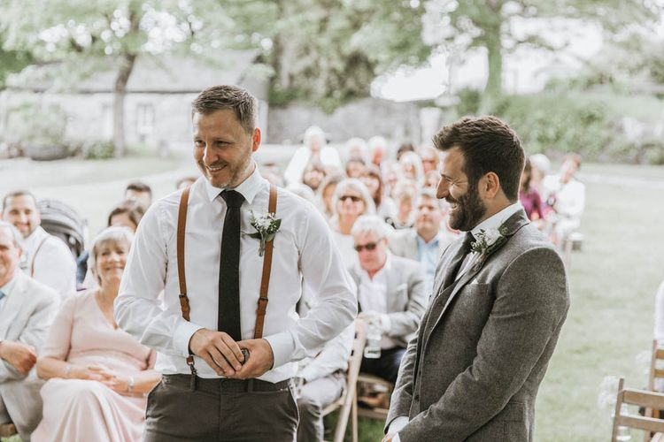 Groom in Three-piece Wool Suit and Best Man in Chino's  and Braces Laughing Together at the Altar