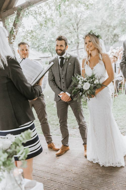 Wedding Ceremony at The Green, Cornwall with Bride in Lace Wedding Dress and Groom in Three-piece Wool Suit