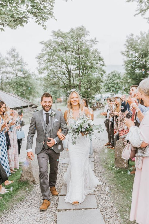 Confetti Moment with Bride in Lace Wedding Dress and Groom in Wool Suit