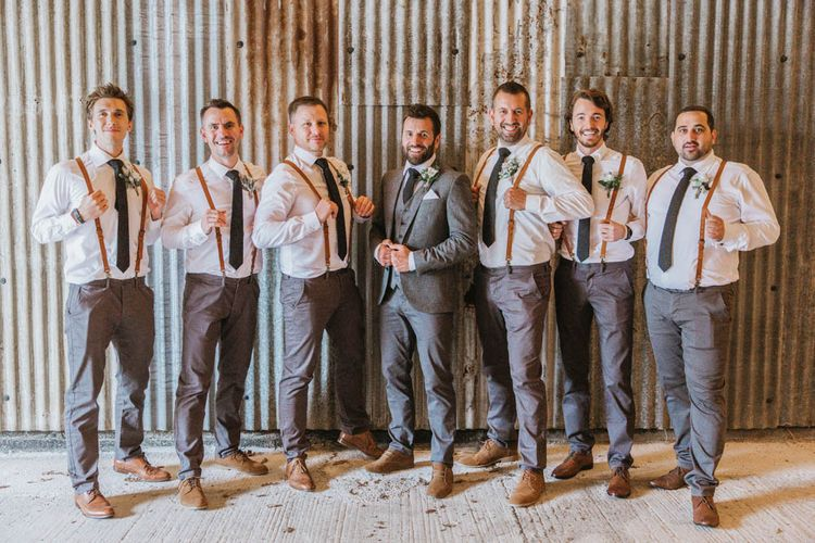 Groom in Three-Piece Wool Suit and Groomsmen in Chino's and Braces
