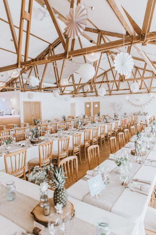 Rustic Barn Reception at The Green, Cornwall with Paper Lanterns, Tree Slice Centrepieces and Burlap Table Runners
