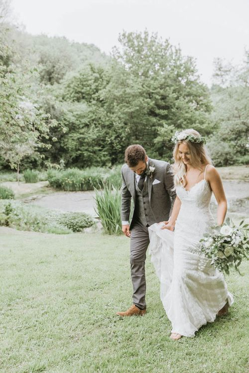 Bride in Lace Wedding Dress and Flowers Crown and Groom in Brown Wool Suit
