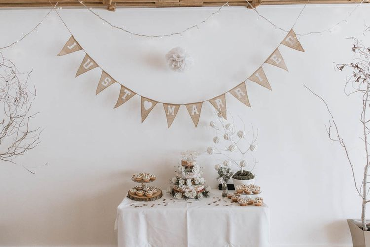 Cake Table with Tree Slice Cake Stand and Burlap Bunting