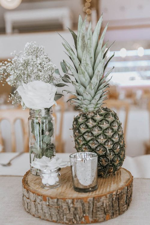 Table Centrepiece with Tree Slice, Pineapple and Flower Stems in Jars
