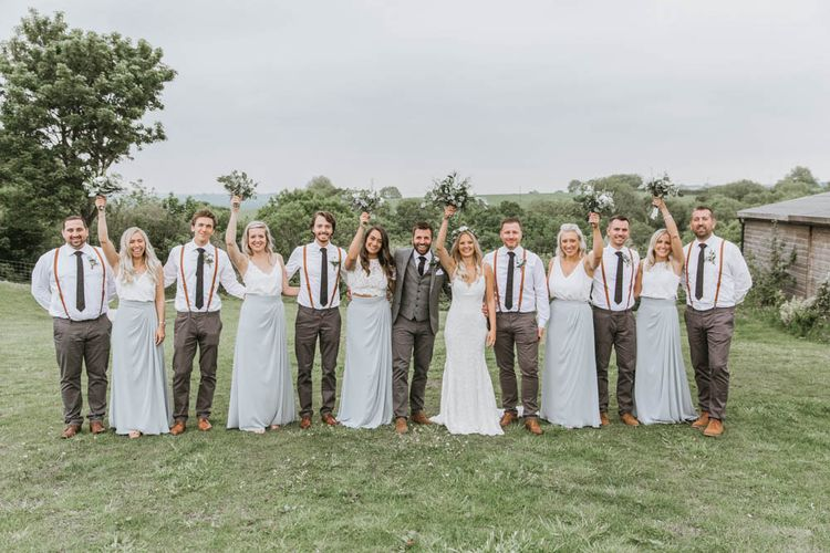 Wedding Party Portrait with Bride in Lace Wedding Dress, Groom in Wool Suit, Bridesmaids in Separates and Groomsmen in Braces