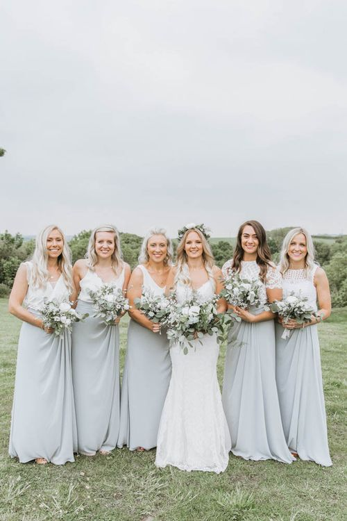 Bridal Party with Bride in Lace Wedding Dress and Flower Crown and Bridesmaids in Separates