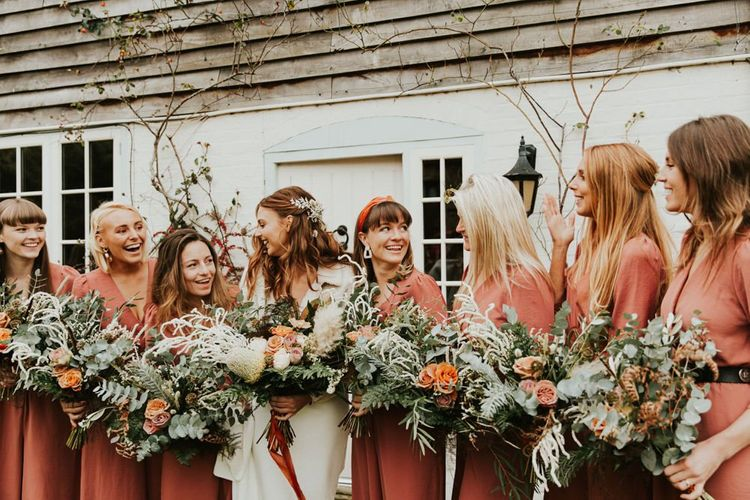 Large bouquet and bridesmaid jumpsuit for November wedding