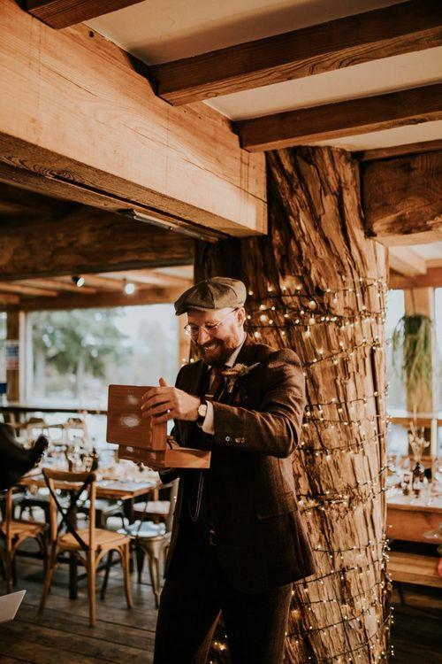 Groom opens present before wedding