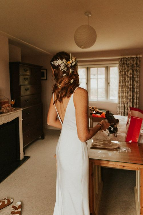 Low back Luna Willow Bridal dress with flower hairpiece