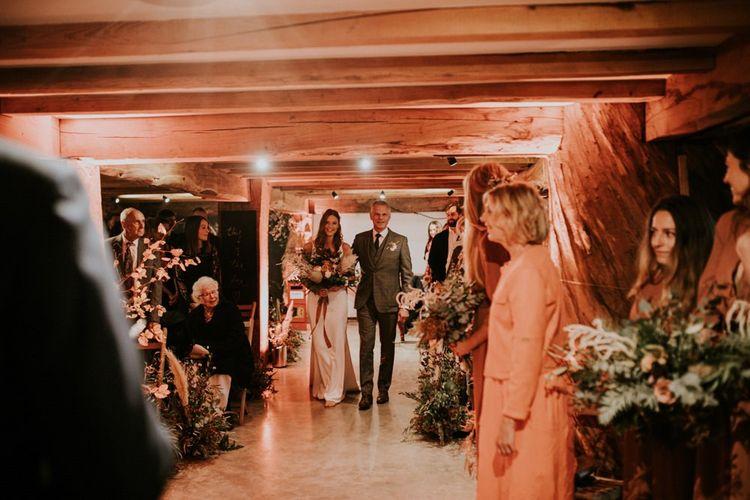 Bride walks down the aisle at wedding venue in Kent