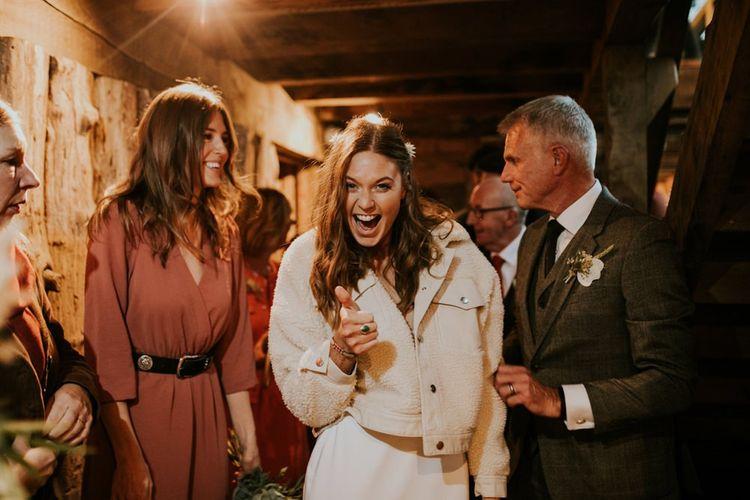 Cream jacket for bride at Autumn Wedding