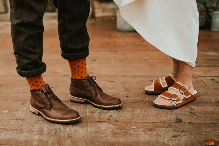 Bridal Birkenstocks and brown boots for groom