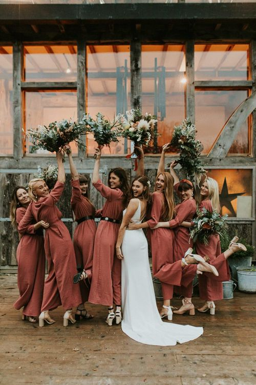 Bride with bridal party in bridesmaid jumpsuit