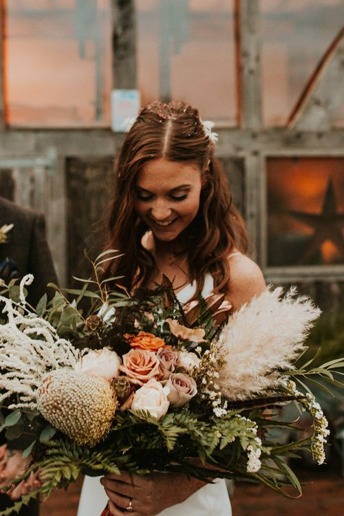 Bridal bouquet for Autumn theme wedding with pampas grass