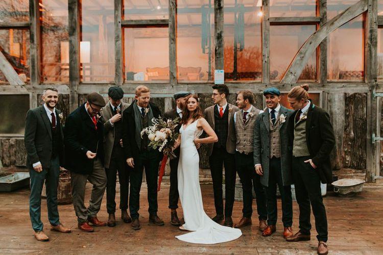 Bride with groomsmen at Kent wedding venue