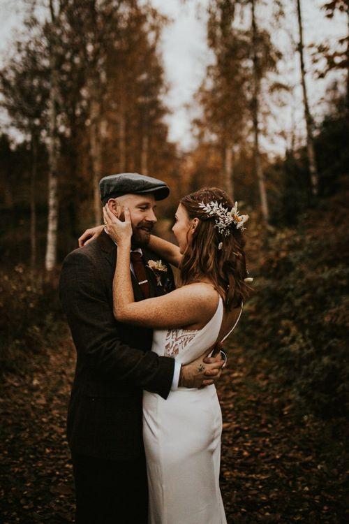 Bride and groom at woodland wedding