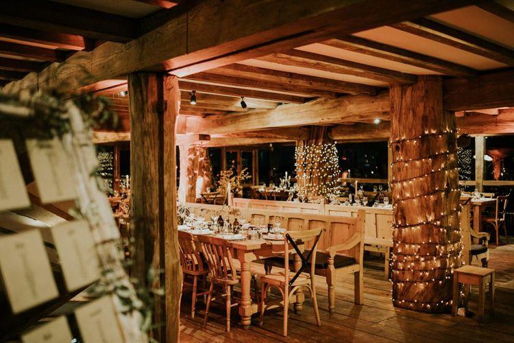 Cosy wedding breakfast with fairy lights