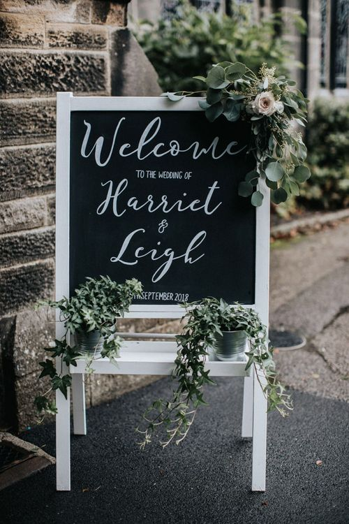 Chalkboard wedding sign outside the church ceremony