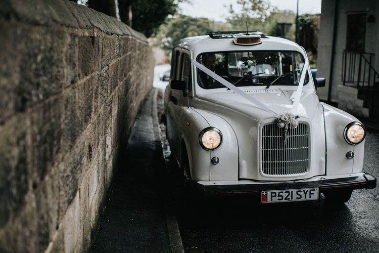 White taxi to transport the bridal party in multiway bridesmaid dresses