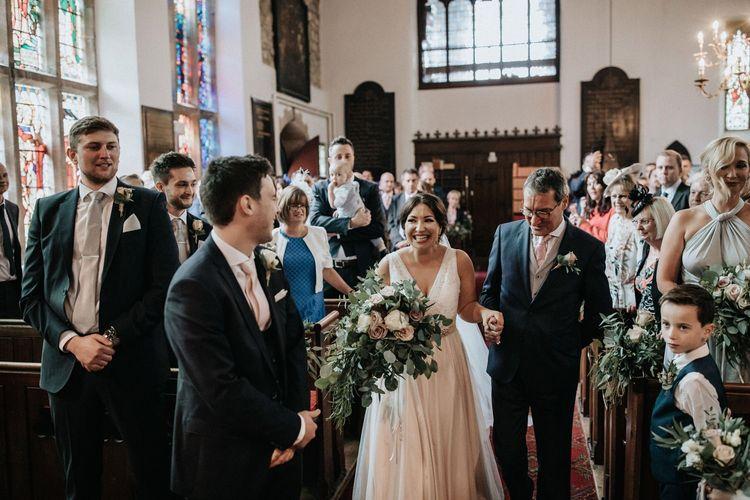 Church wedding ceremony with bride in Catherine Deane wedding dress