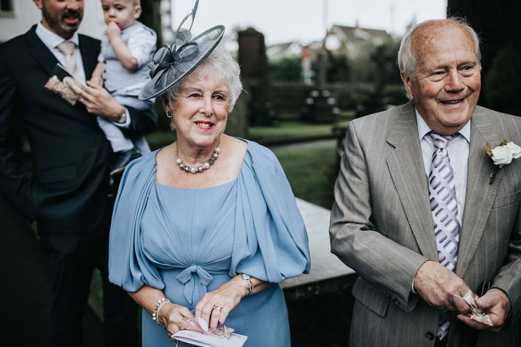 Wedding guests with lady in blue dress and hat