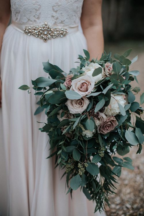 Bridal bouquet with pink roses, eucalyptus and sweet september's.