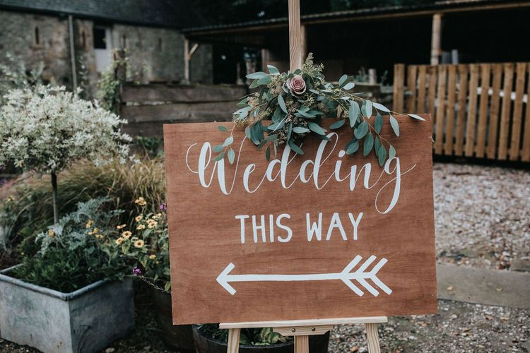 Wooden wedding welcome sign with flowers