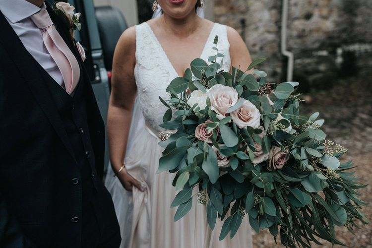Oversized bridal bouquet with eucalyptus, roses and sweet September flowers.
