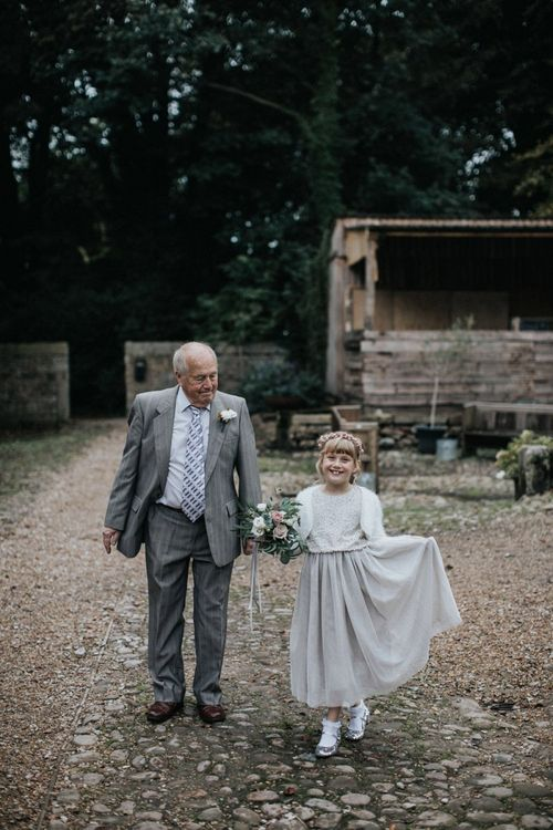 Flower girl in grey, silver and white outfit and multiway bridesmaid dresses