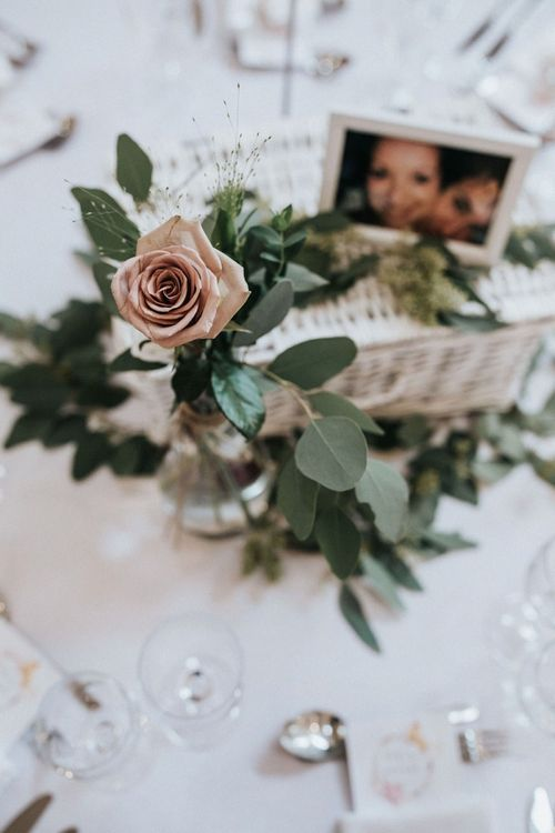 Flower centrepiece with eucalyptus and roses.