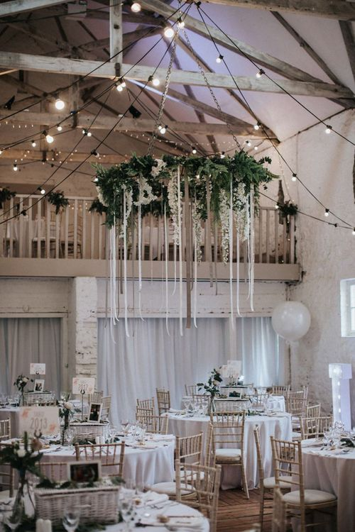 Hanging foliage chandelier with ribbon detail