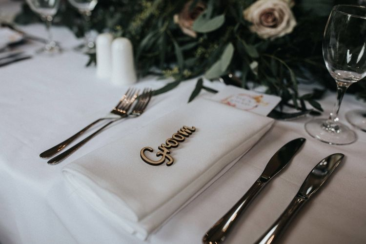 Wooden groom name place setting for wedding with multiway bridesmaid dresses