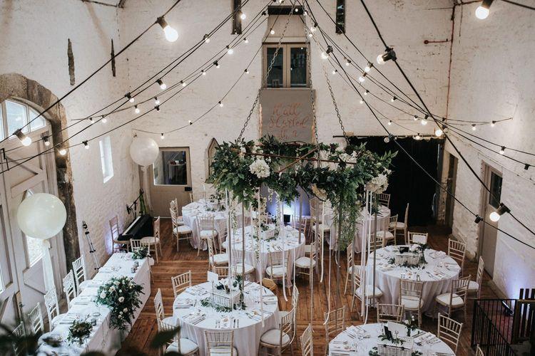 Festoon lights in contemporary barn wedding venue