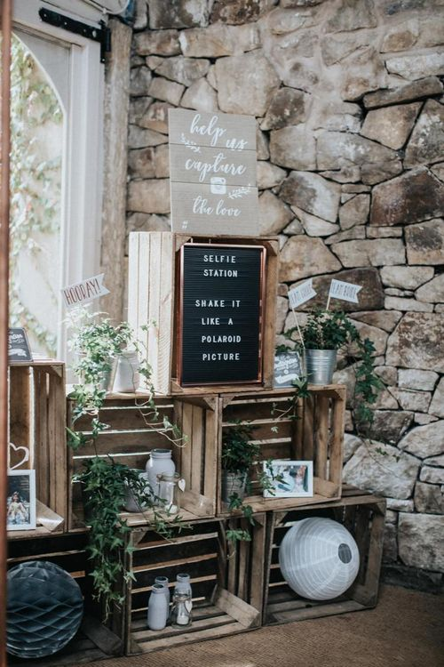 Selfie station wedding decor with crates and peg board sign
