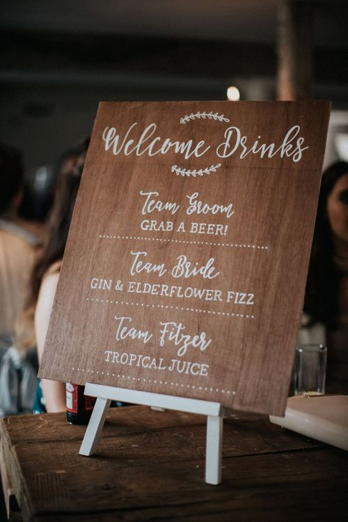 Wooden welcome drinks cocktail menu for wedding with multiway bridesmaid dresses