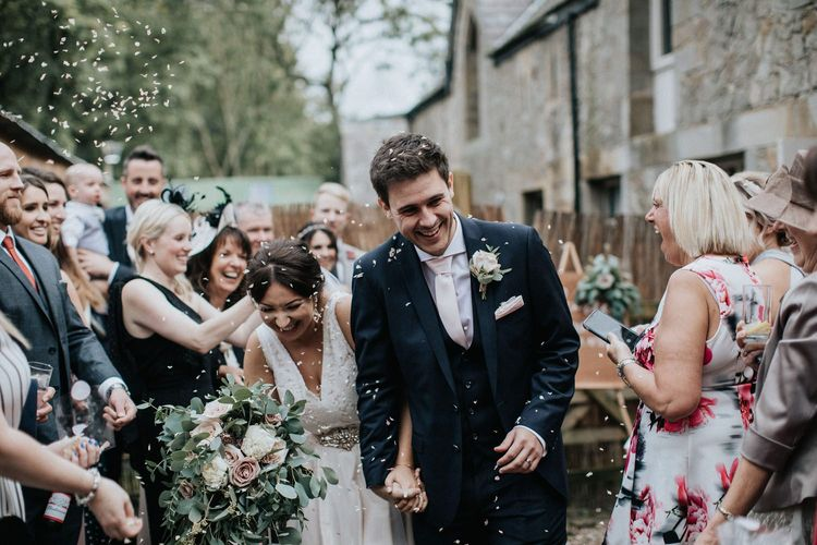 Bride and Groom confetti moment with Shropshire biodegradable petals