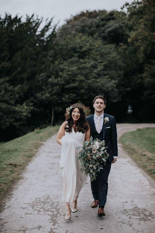 Bride in Catherine Deane wedding dress and Harriet Wilde wedding shoes